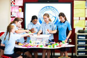 Students packing a hamper of food for St Vincent de Paul Society