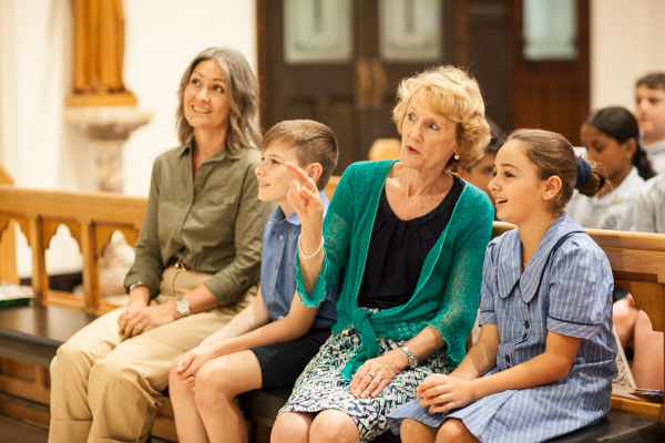 Students and Family Educator sitting and having a conversation inside church